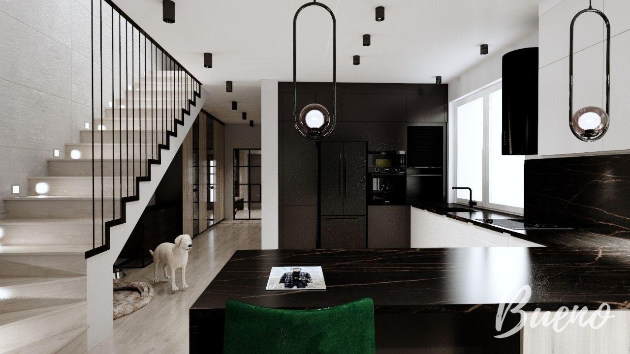 Biała nowoczesna kuchnia z czarnym blatem