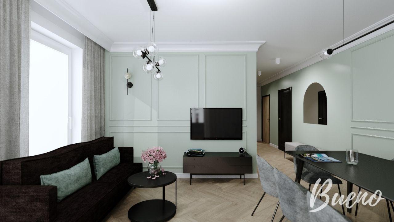 Salon z miętową ścianą i szarymi krzesłami