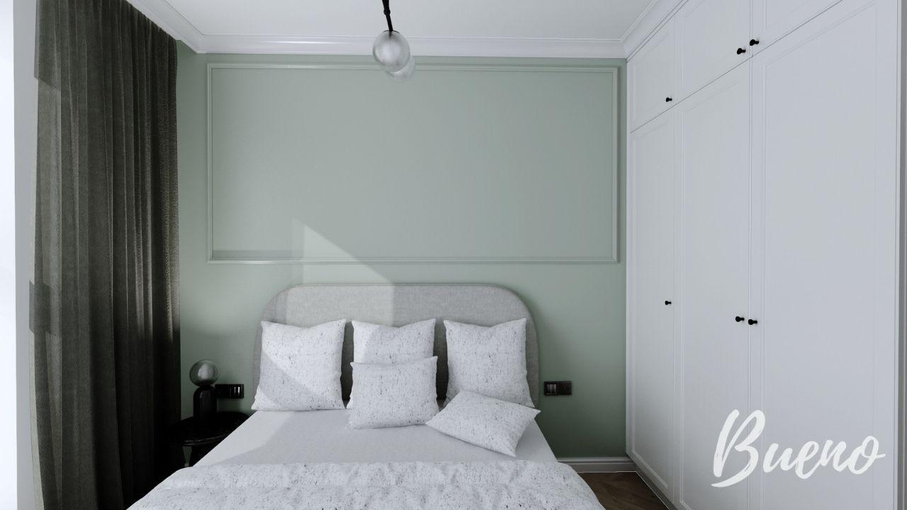 sypialnia z mietową ścianą i sztukaterią